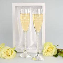 Personalised Engraved Crystal Stemmed Anniversary Champagne Glasses present in Silk Lined Gift Box.