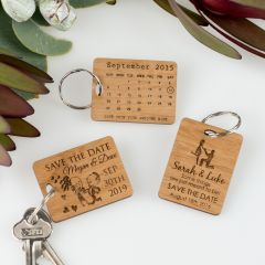 Custom designed engraved wooden wedding save the date keyrings