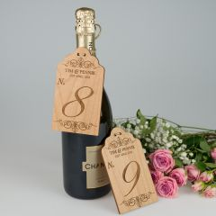 Personalised wooden engraved wedding reception table numbers for wine bottles