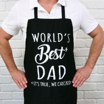 """Black Father's Day Apron with White Printed """"World's best dad, Its true we checked"""" Present"""