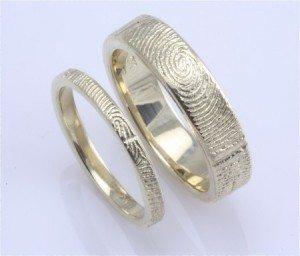http://apracticalwedding.com/2011/09/brent-jess-handcrafted-fingerprint-wedding-rings/